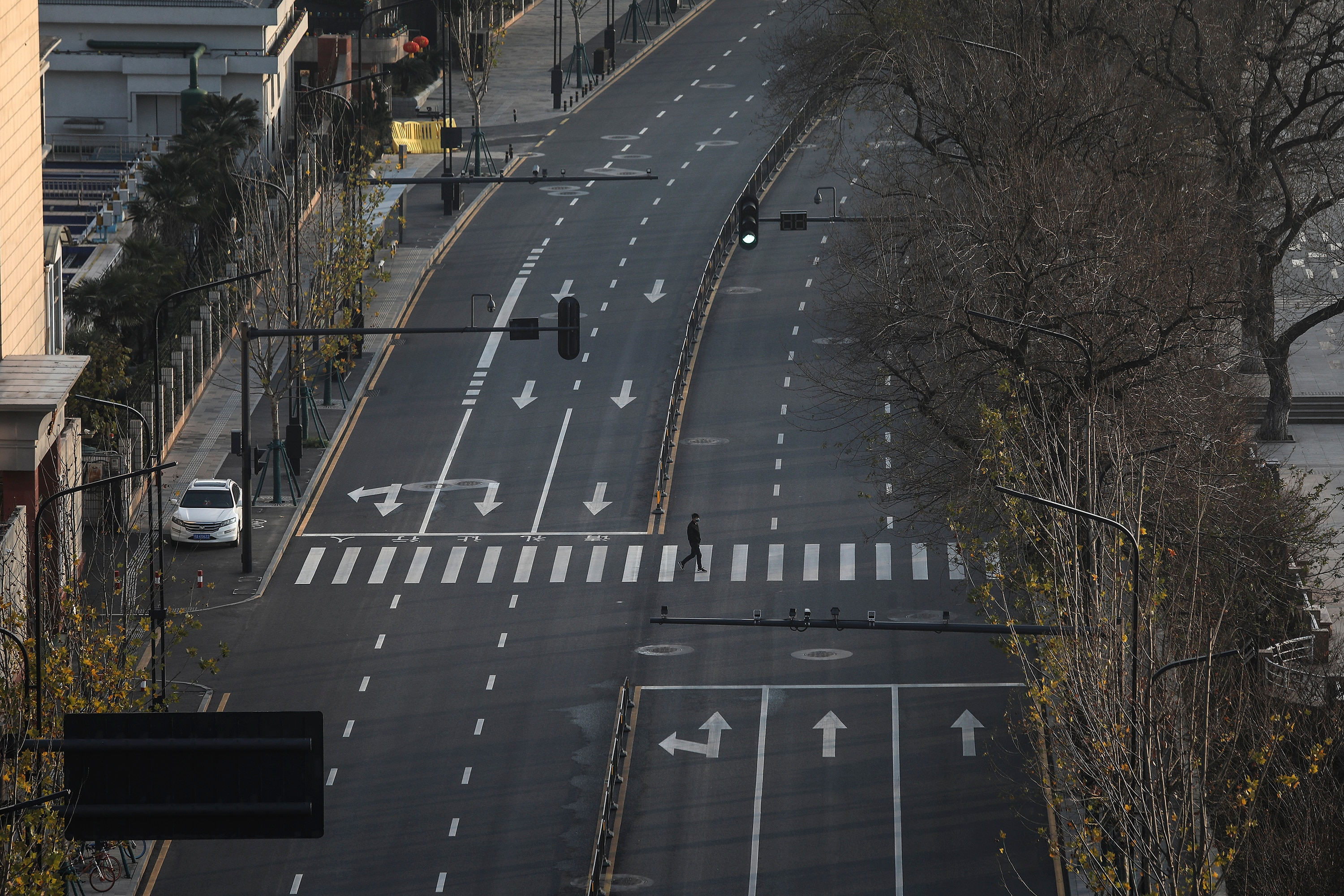 The streets of Wuhan fall silent during a lockdown in the wake of the coronavirus outbreak.