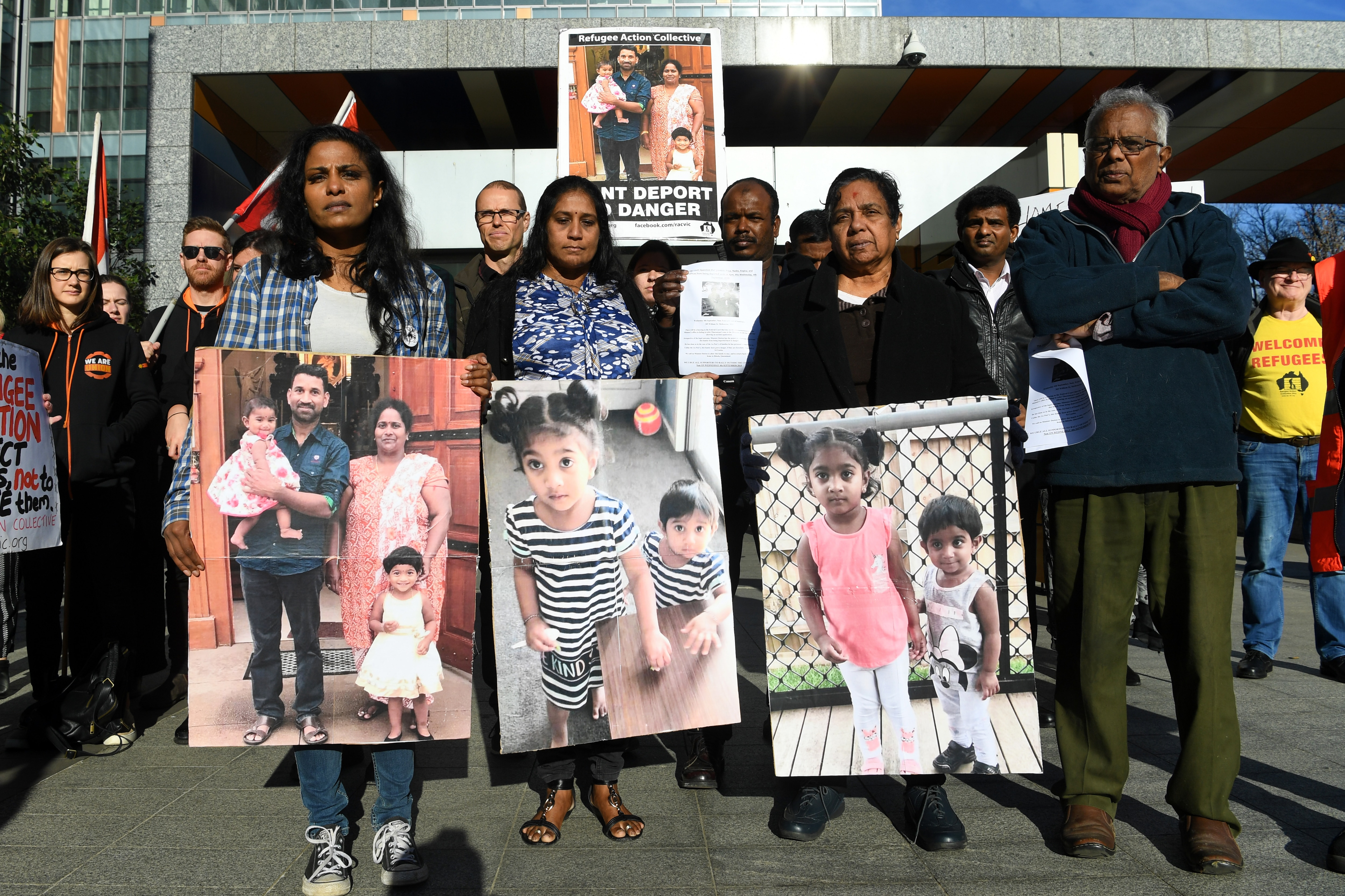Supporters of the Biloela Tamil family gather outside the Federal Court in Melbourne.