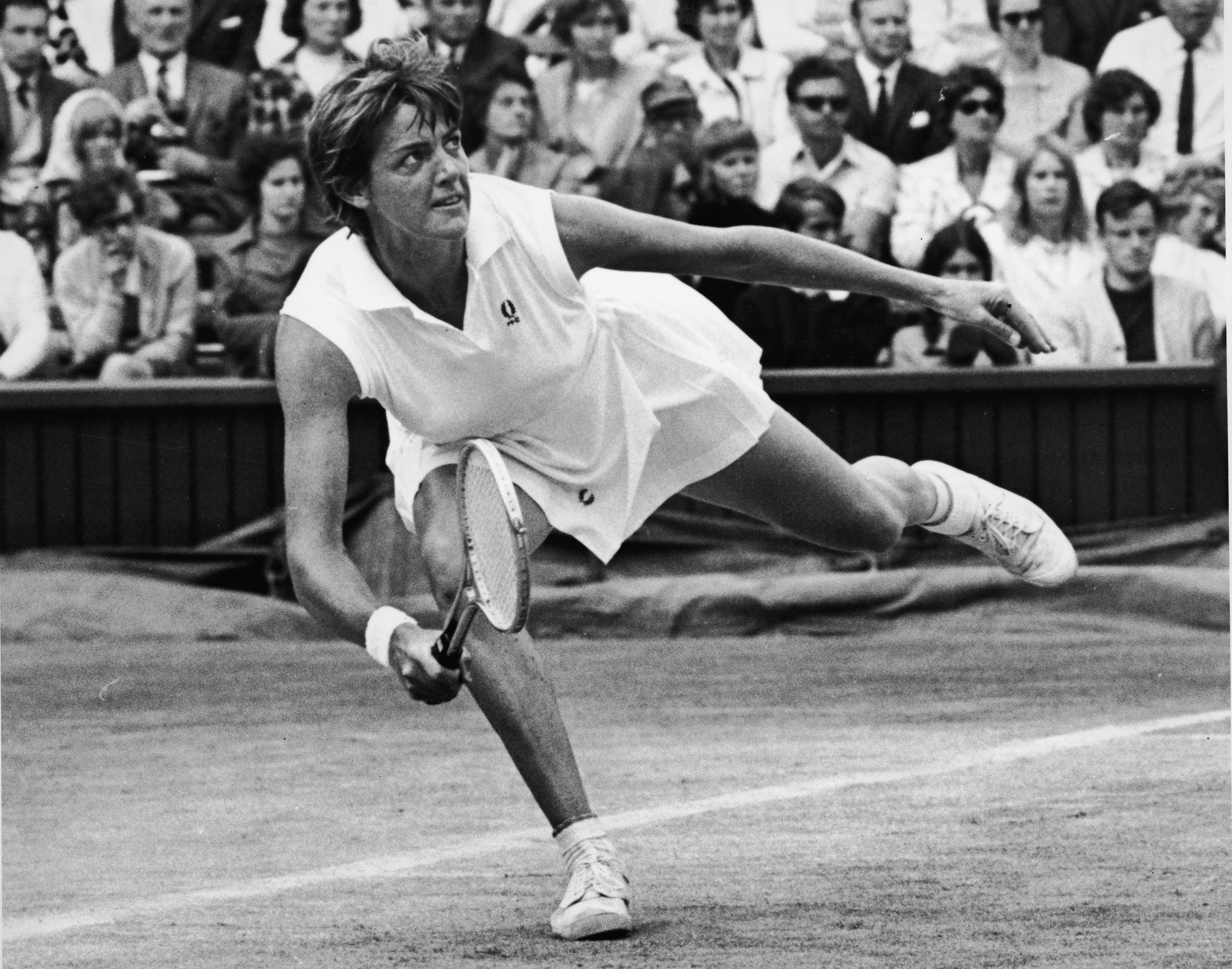 Australian tennis player Margaret Court lunges for a ball during her Wimbledom semi-final match against Rosemary Casals in 1970.