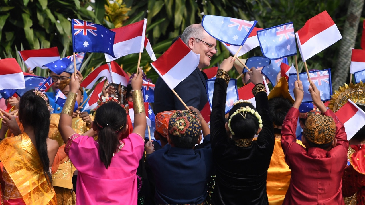 Australian Prime Minister Scott Morrison is greeted by kids in traditional clothing during a welcoming ceremony at Bogor Presidential Palace.