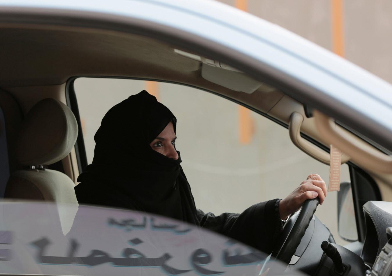 Aziza al-Yousef drives a car on a highway in Riyadh, Saudi Arabia in 2014.