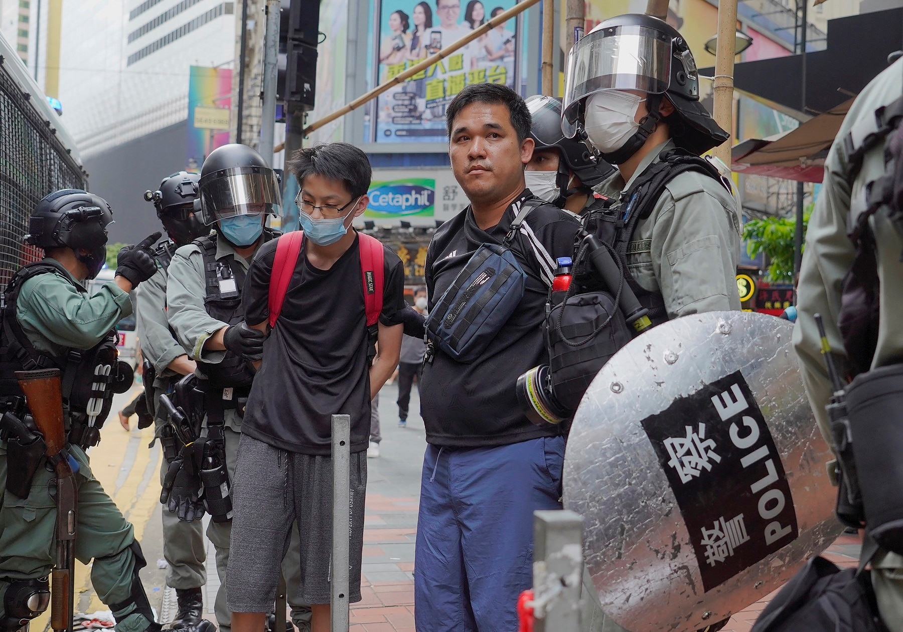 Riot police arrest protesters during a rally against a proposed security law.