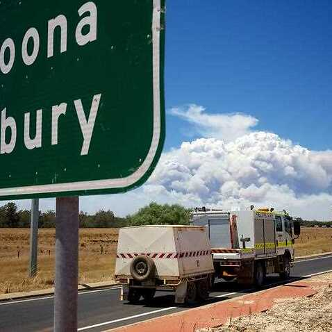 Smoke clouds caused by a large bush fire near the town of Waroona and the surrounding area seen from the turn off to the South Western Highway near Pinjarra, Western Australia.