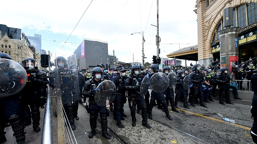 Police during an anti-lockdown protest in the central business district of Melbourne on 21 August 2021.
