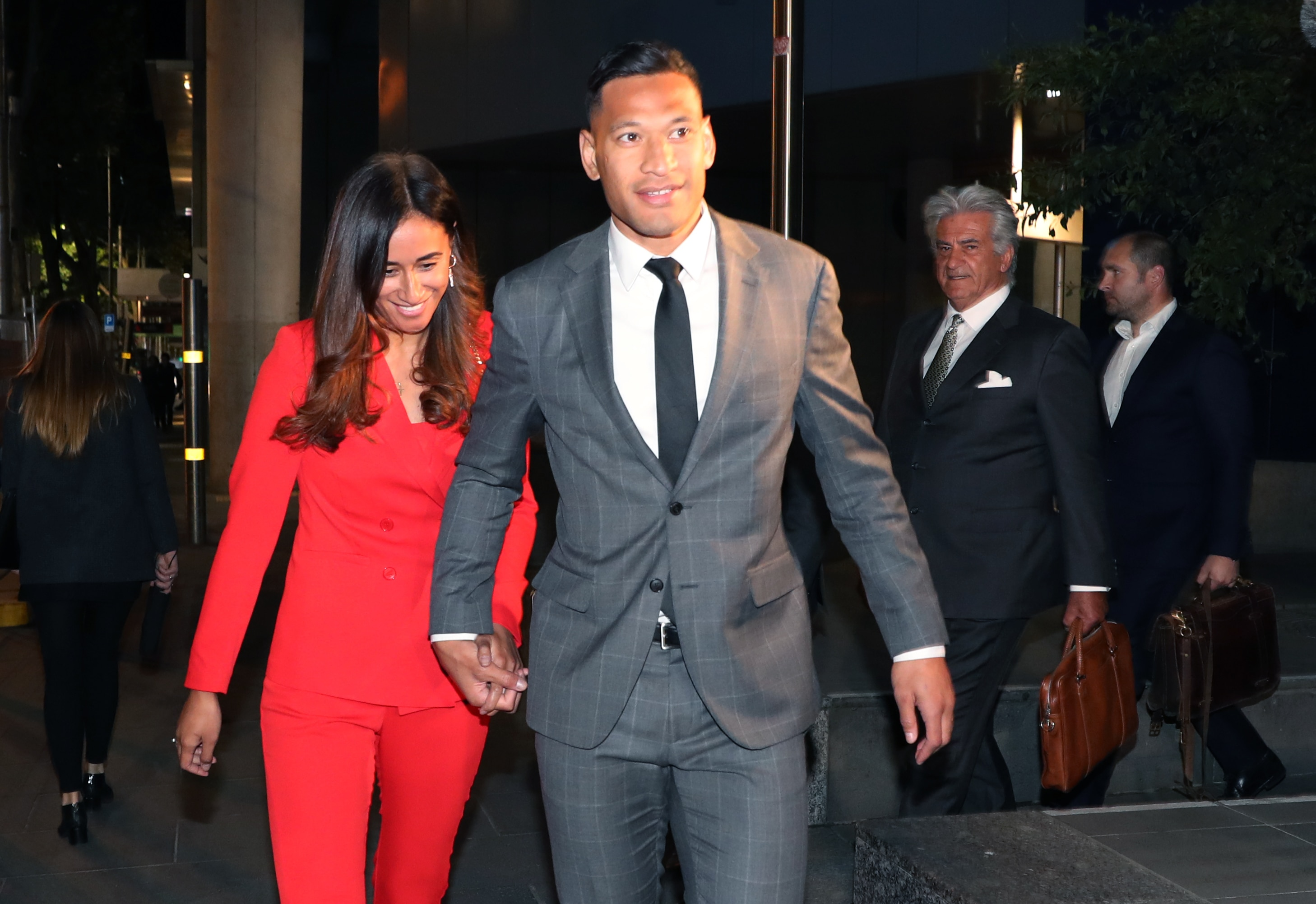 Israel Folau and his wife Maria leave the Federal Court in Melbourne after a long mediation with Rugby Australia.