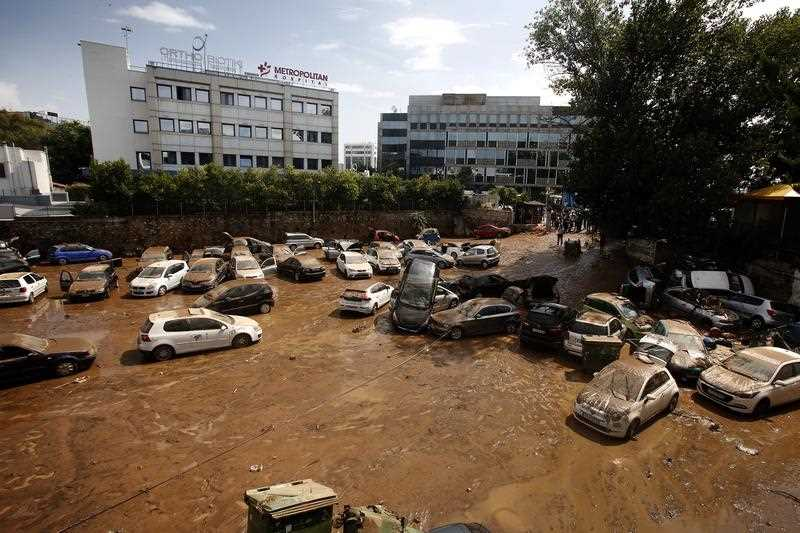 Piled up vehicles are seen at a street after a rainstorm in Maroussi, suburb of Athens, Greece, 26 July 2018.