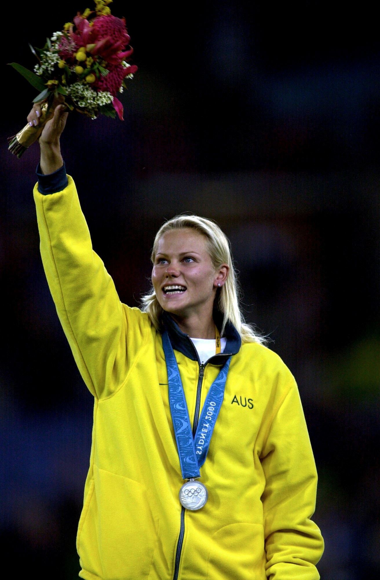 Grigorieva salutes the crowd after receiving her silver medal.
