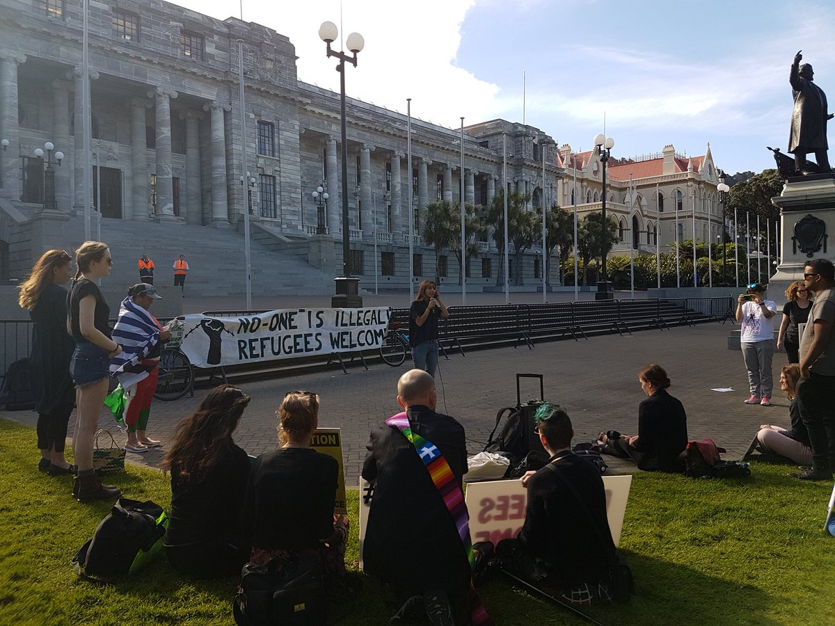Protesters tell stage a vigil outside New Zealand Parliament House in support of refugees on Manus Island.