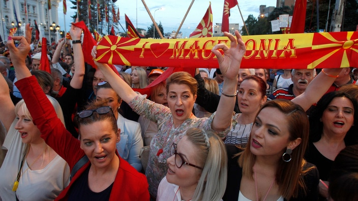 People chant during a protest in front of the Government building in Skopje, Macedonia.