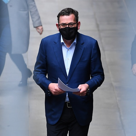 Victorian Premier Daniel Andrews arrives to a press conference in Melbourne, Friday, August 7, 2020. Victoria has recorded 450 cases of coronavirus overnight and 11 deaths. (AAP Image/James Ross) NO ARCHIVING