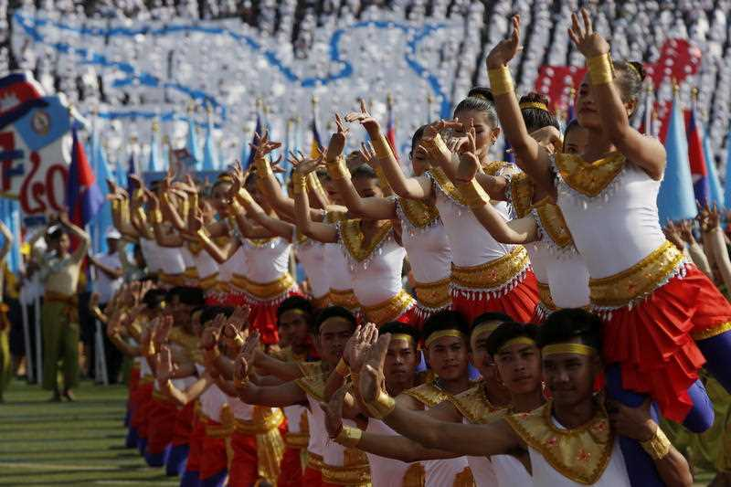 Cambodian dancers perform during a Victory Day ceremony at the Olympic National Stadium in Phnom Penh, Cambodia.