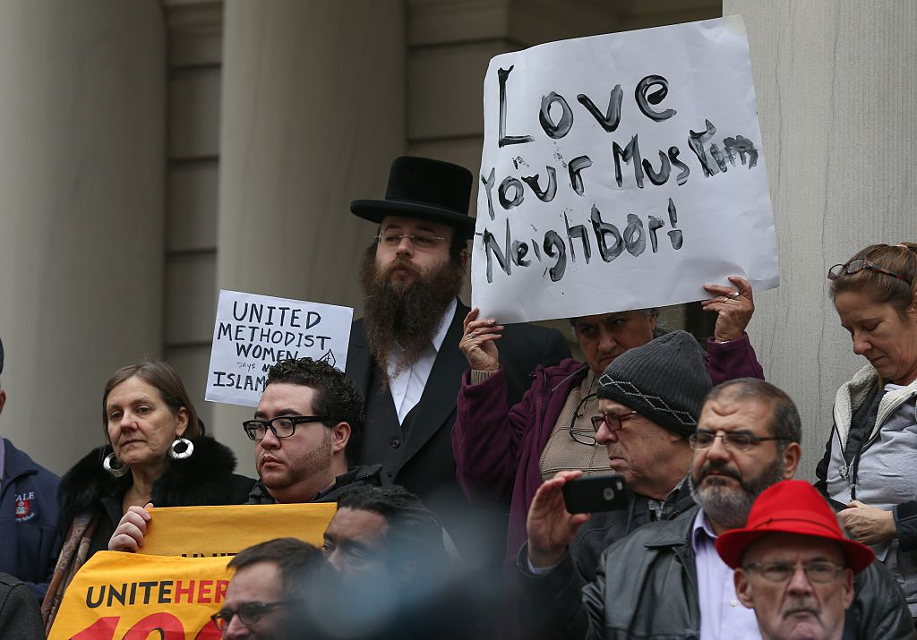 Religious leaders protest against Donald Trump's anti-Muslim hate speech in front of the New York City Hall December 2015.