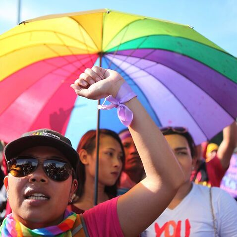 LGBT Activists Rally To Mark IWD