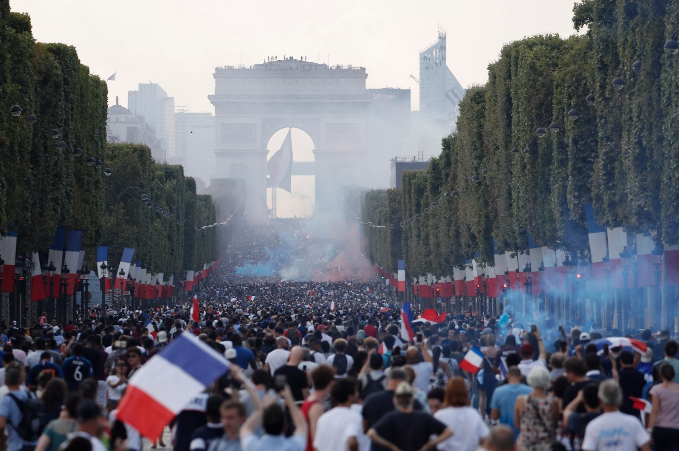 French supporters gather on the Champs-Elysees avenue after the victory of France at the FIFA World Cup 2018 final match