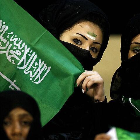 Veiled female Saudi football fans