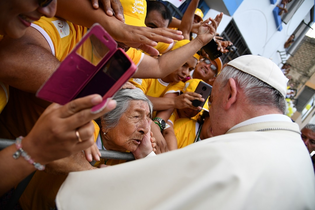 Pope Francis greets a woman at Plaza de Armas square in the Peruvian city of Trujillo.