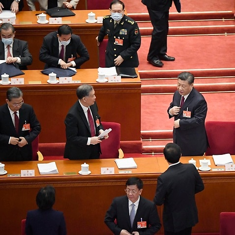Chinese President Xi Jinping (centre) and Premier Li Keqiang (far right) at the opening ceremony of the National People's Congress.