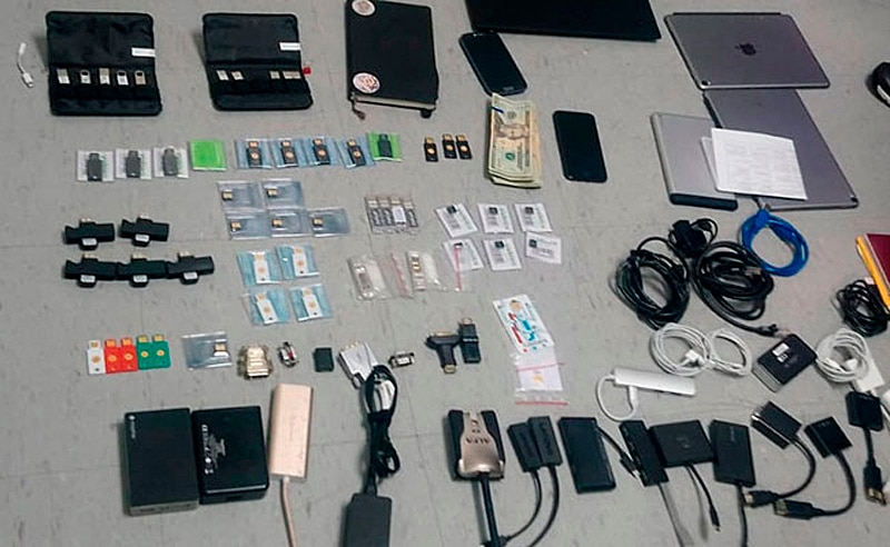 A handout photo shows items which were obtained in the raid on Ola Bini's house.