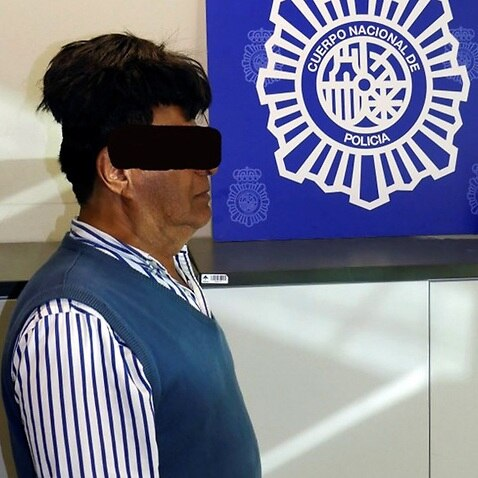 An undated handout composite photo released by the Spanish National Police on 16 July 2019 shows a man who was detained at Barcelona's El Prat airport
