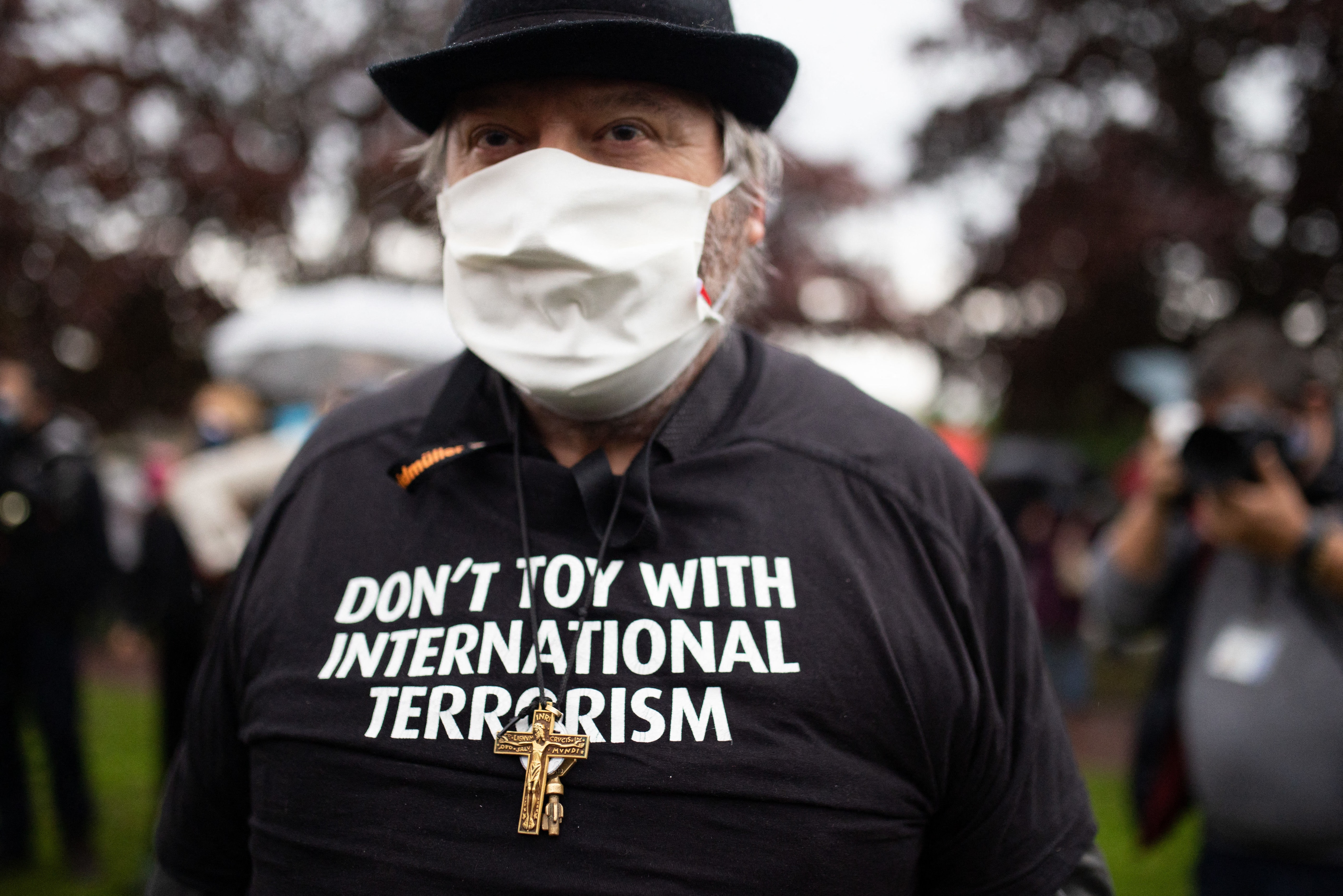 People wearing a shirt Don't toy with international terrorism gather at the middle school in Conflans-Sainte-Honorine, northwest of Paris, on 20 October, 2020.