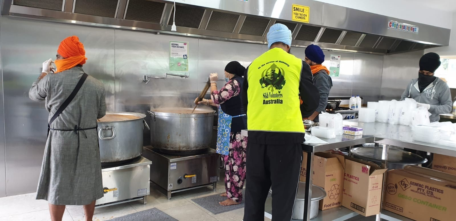 A team of Sikh volunteers preparing meals at a community kitchen in Melbourne's south-east.