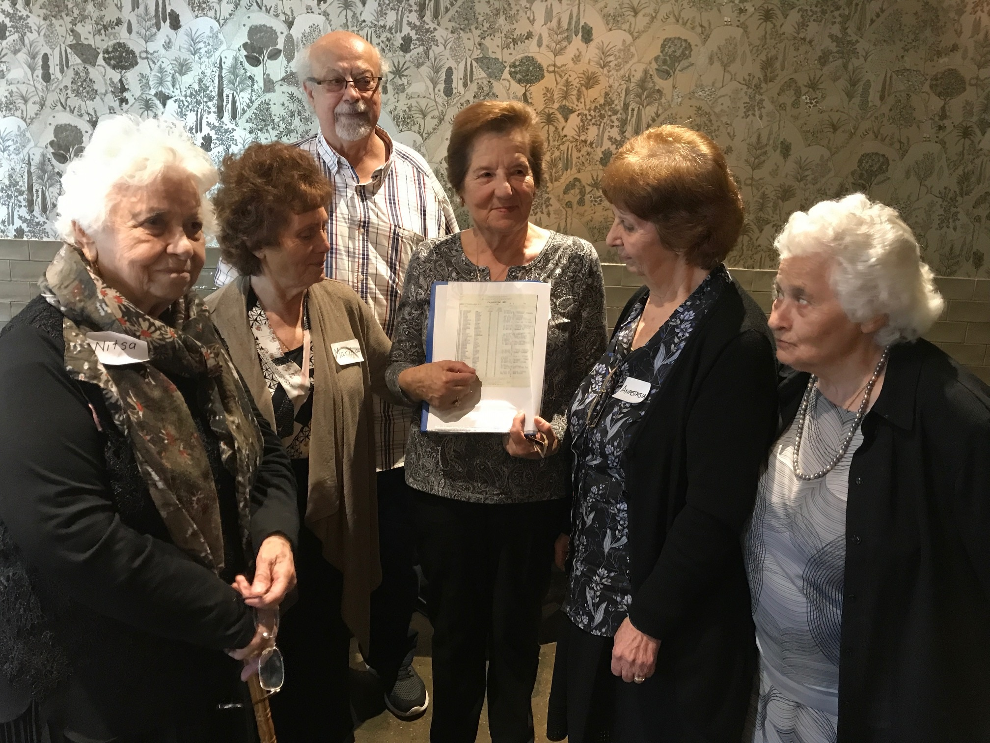 Peter Photakis with some of the women who came to Australia on the Begona at a reunion in Adelaide in 2017.