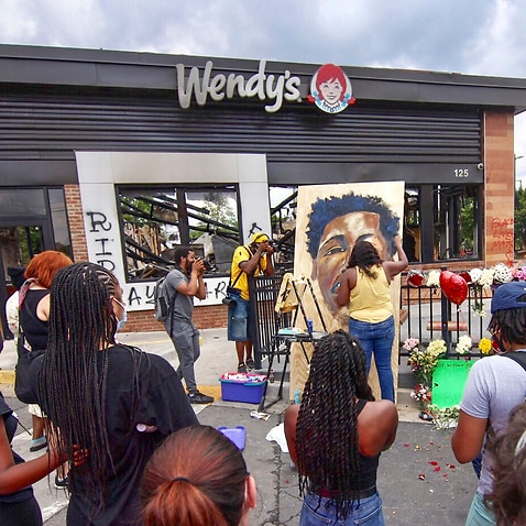 The parking lot of the fire-ravaged Wendy's in Atlanta where Rayshard Brooks, a 27-year-old black man, was shot and killed by Atlanta police.
