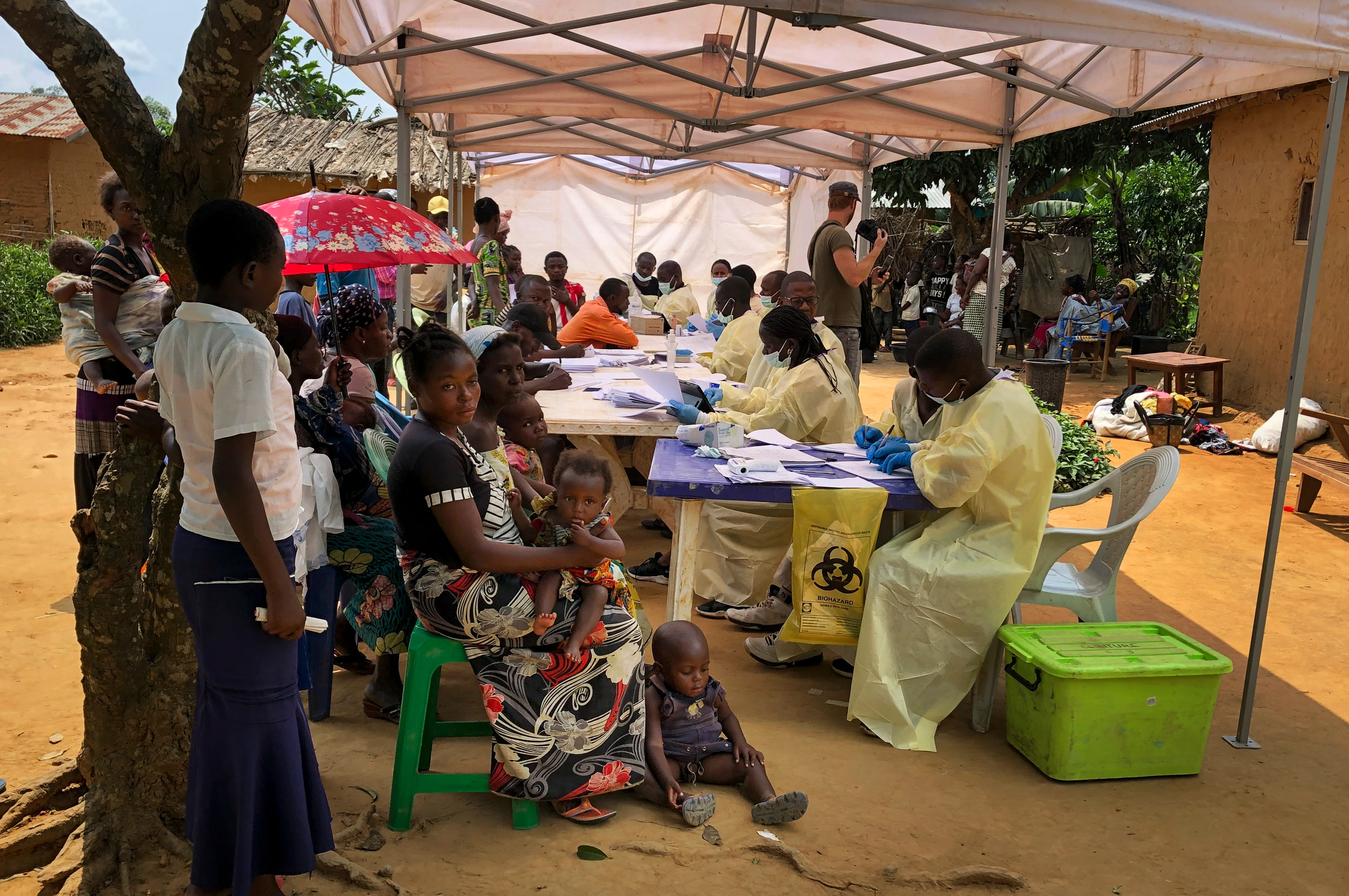 A woman and her children wait to receive Ebola vaccinations, in the village of Mabalako, in eastern Congo.