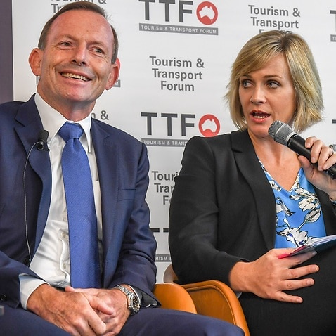 Member for the seat of Warringah Tony Abbott with Independent candidate for the Federal Seat of Warringah Zali Steggall during the Tourism & Transport Forum?s 2019 Leadership Summit in Sydney, March 8, 2019. (AAP Image/Peter Rae) NO ARCHIVING