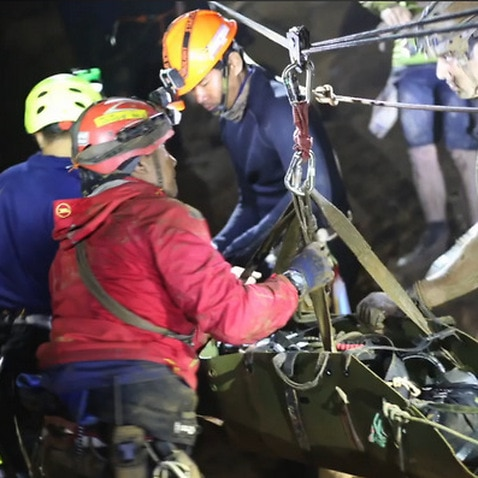 One of the 12 boys are carried out of the cave on stretchers.