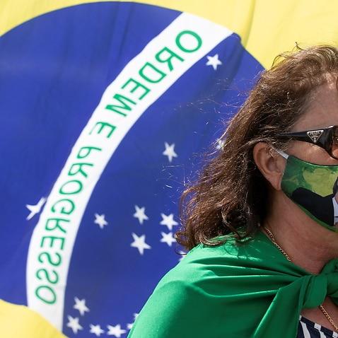 A supporters of Brazilian President Jair Bolsonaro attends a rally in Brasilia, Brazil, 19 April 2020.