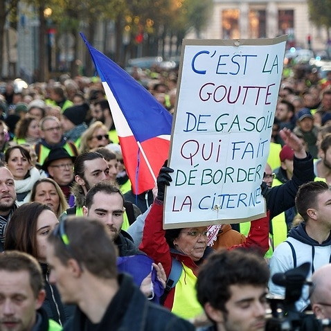 Protesters wearing yellow jackets a symbol of French drivers' protest against higher fuel prices.