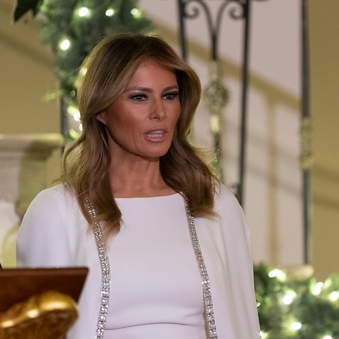 epa08067217 First lady Melania Trump listens as United States President Donald J. Trump (not pictured) makes remarks at the Congressional Ball at the White House in Washington, DC, USA, 12 December 2019.  EPA/CHRIS KLEPONIS / POOL