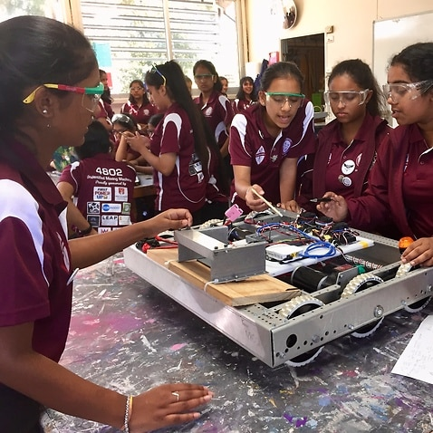 Blacktown Girls High School students prepare their robot for competition in the US.