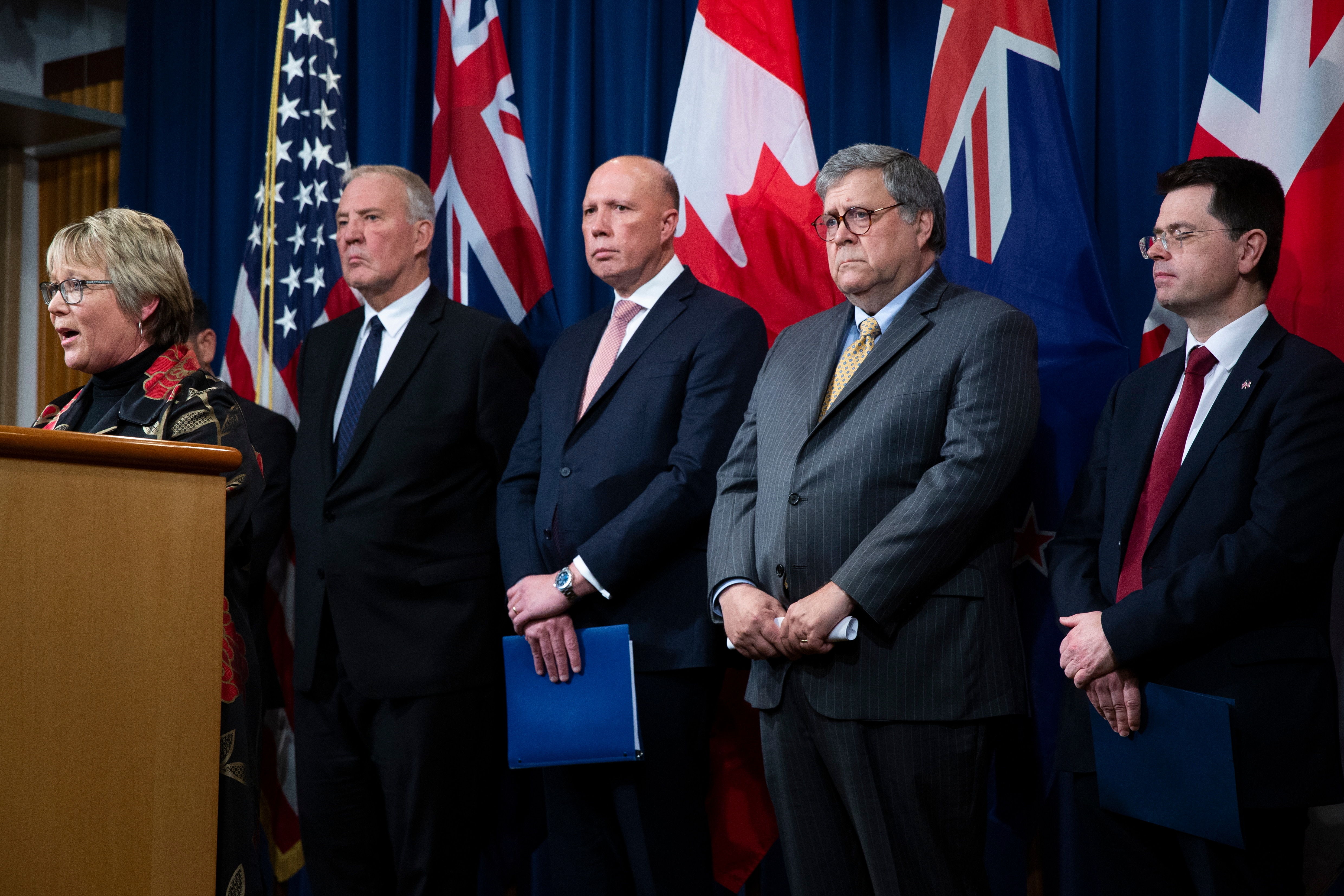 New Zealand Minister of Internal Affairs Tracey Martin speaks in Washington, in front of officials including William Barr and Pe