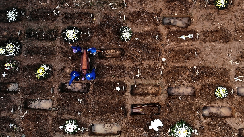 A photograph taken with a drone of a burial of a person who died of COVID-19, in the Caju cemetery, in the northern area of Rio de Janeiro.
