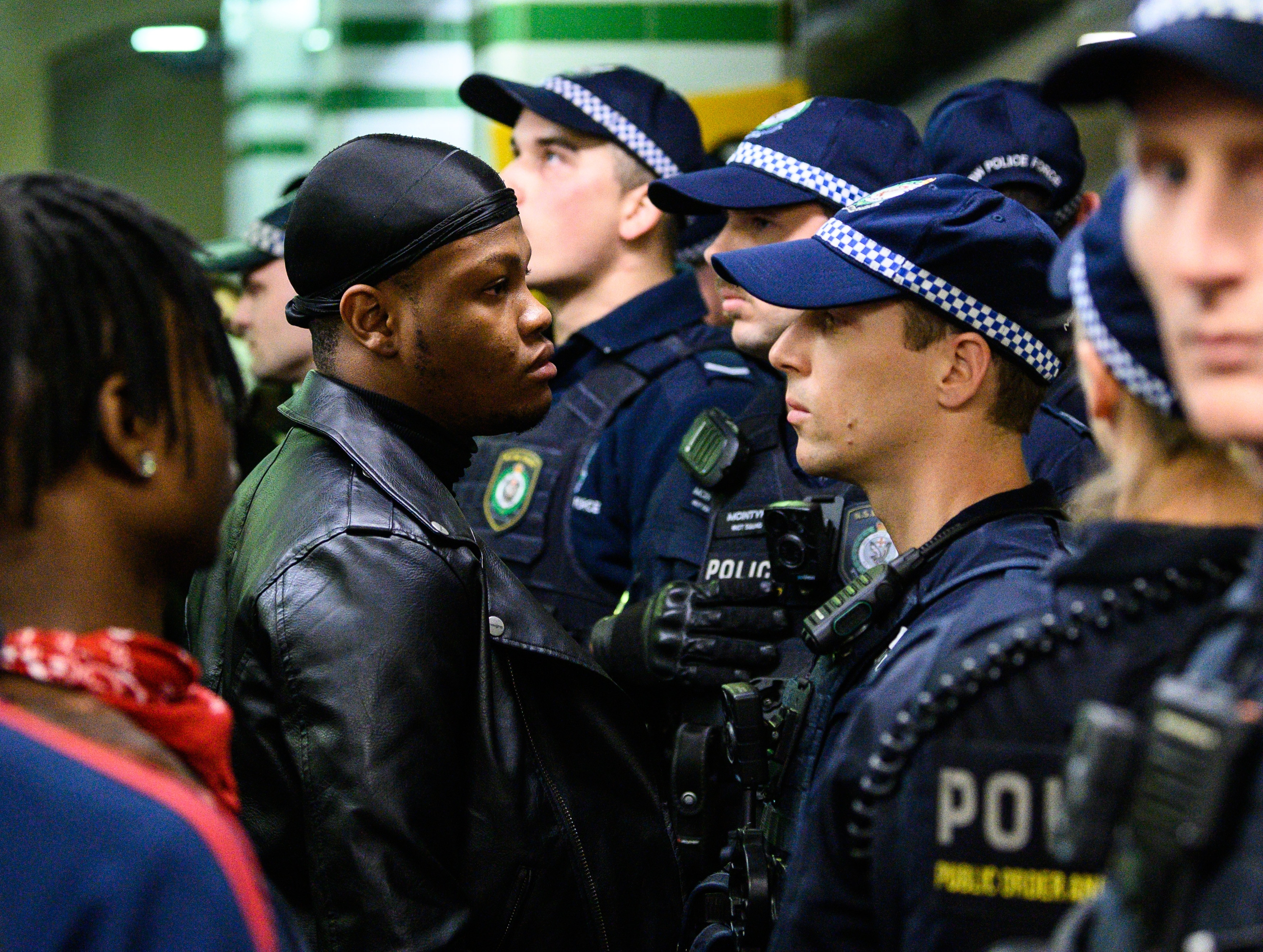 A protestor faces a police officer inside Central Station after a Black Lives Matter rally in Sydney.