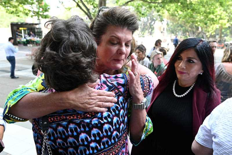 Women embrace outside the Federal Court in Sydney when the vaginal mesh class action judgement was handed down last November.