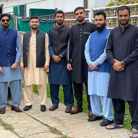 (L-R) Atif Hussain, Usman Tariq, Rana Hamza, Raza Shah, Owais Mughal and Bilal Chaudhary dressed up for Eid at their shared house in Sydney's Lakembah.