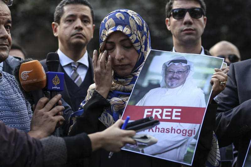 Saudi writer Jamal Khashoggi holds a photo of the missing Saudi journalist Jamal Khashogg.
