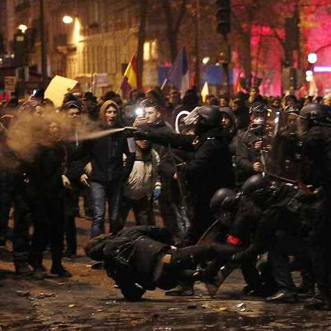 French riot police clash with protesters during a demonstration against pension reforms in Paris, France, 5 December 2019