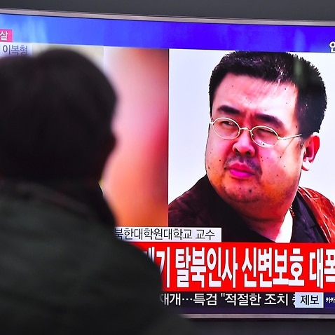 A man watches a television showing news reports of Kim Jong-Nam, the half-brother of North Korean leader Kim Jong-Un, in Seoul on February 14, 2017.