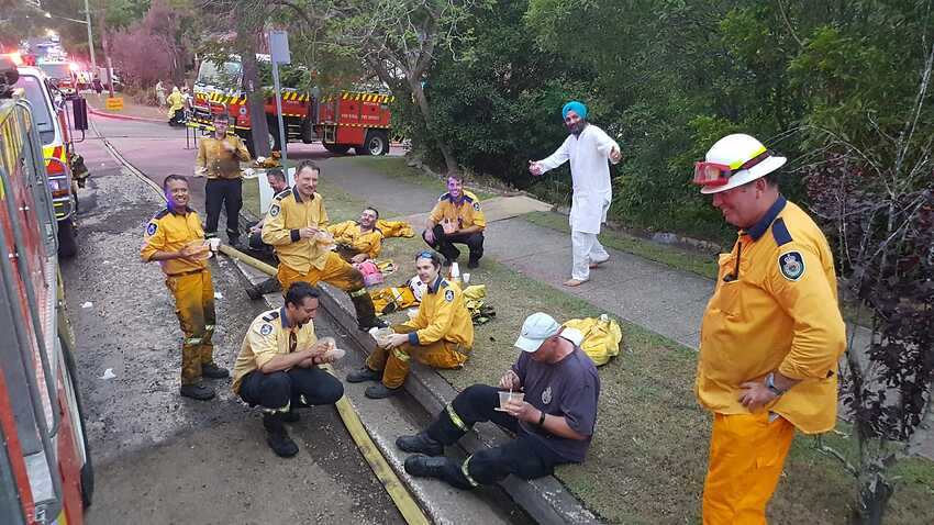Sydney Sikh community treats exhausted firefighters to home-cooked meal