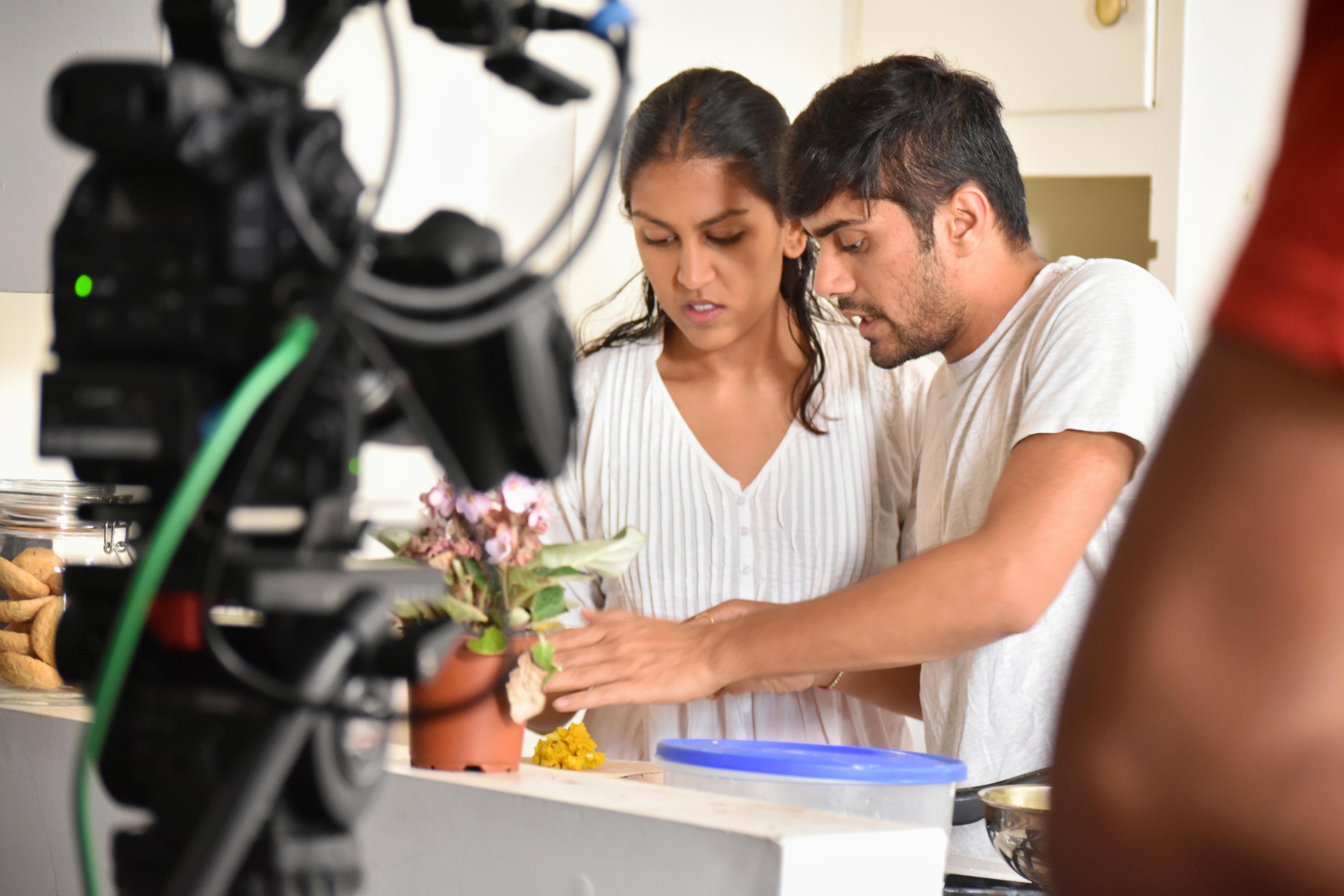 Actress Ria Patel and Director Jay Parikh during the filming of Varta re Varta