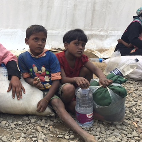 A Rohingya family waiting at the refugee transit centre in Bangladesh.