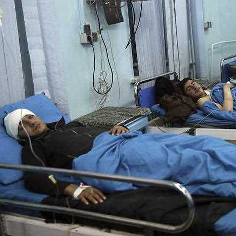 Wounded men lie on beds in a hospital in Kabul following the attack.