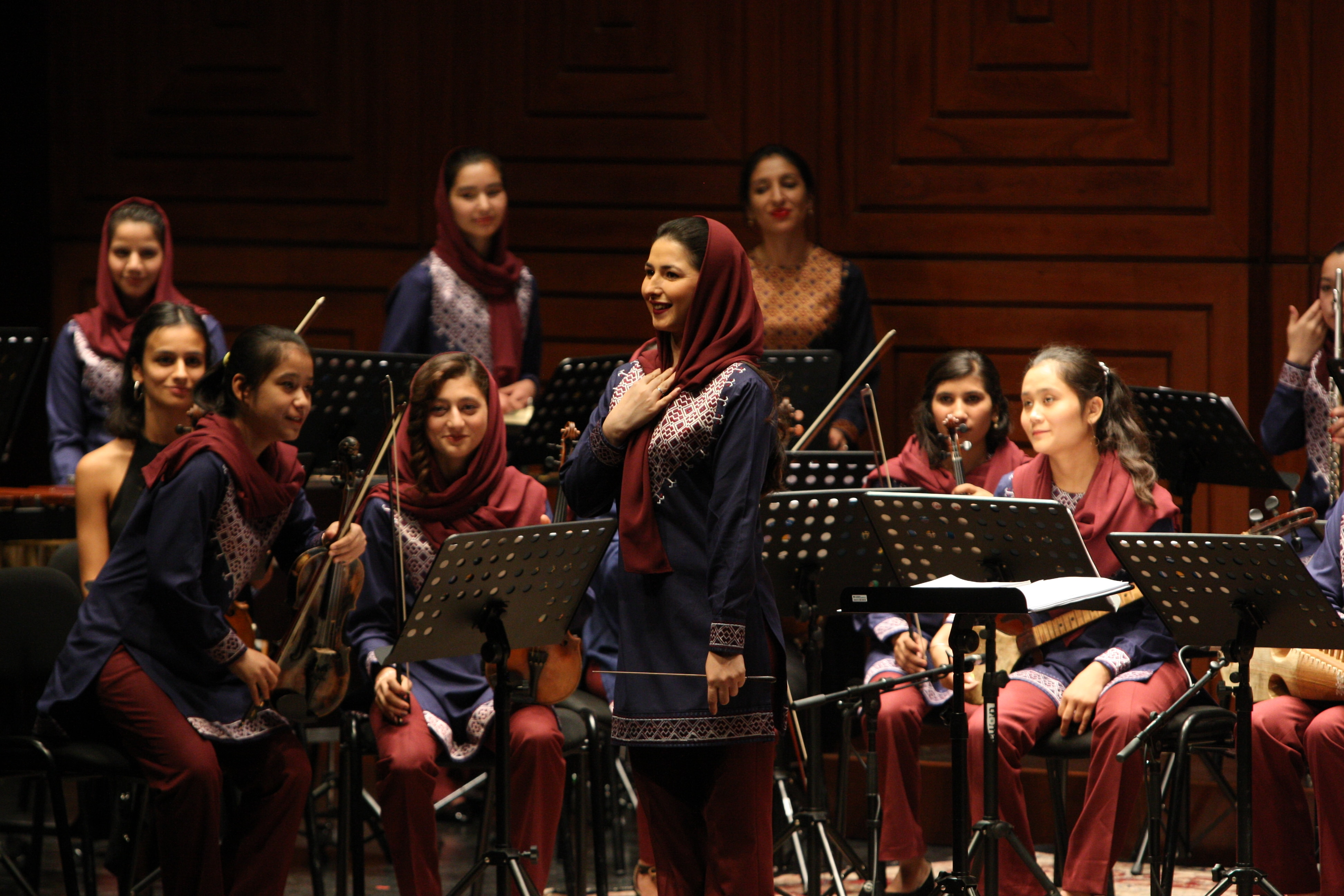 Afghanistan's first female conductor Negin Khpalwak (standing in the middle).