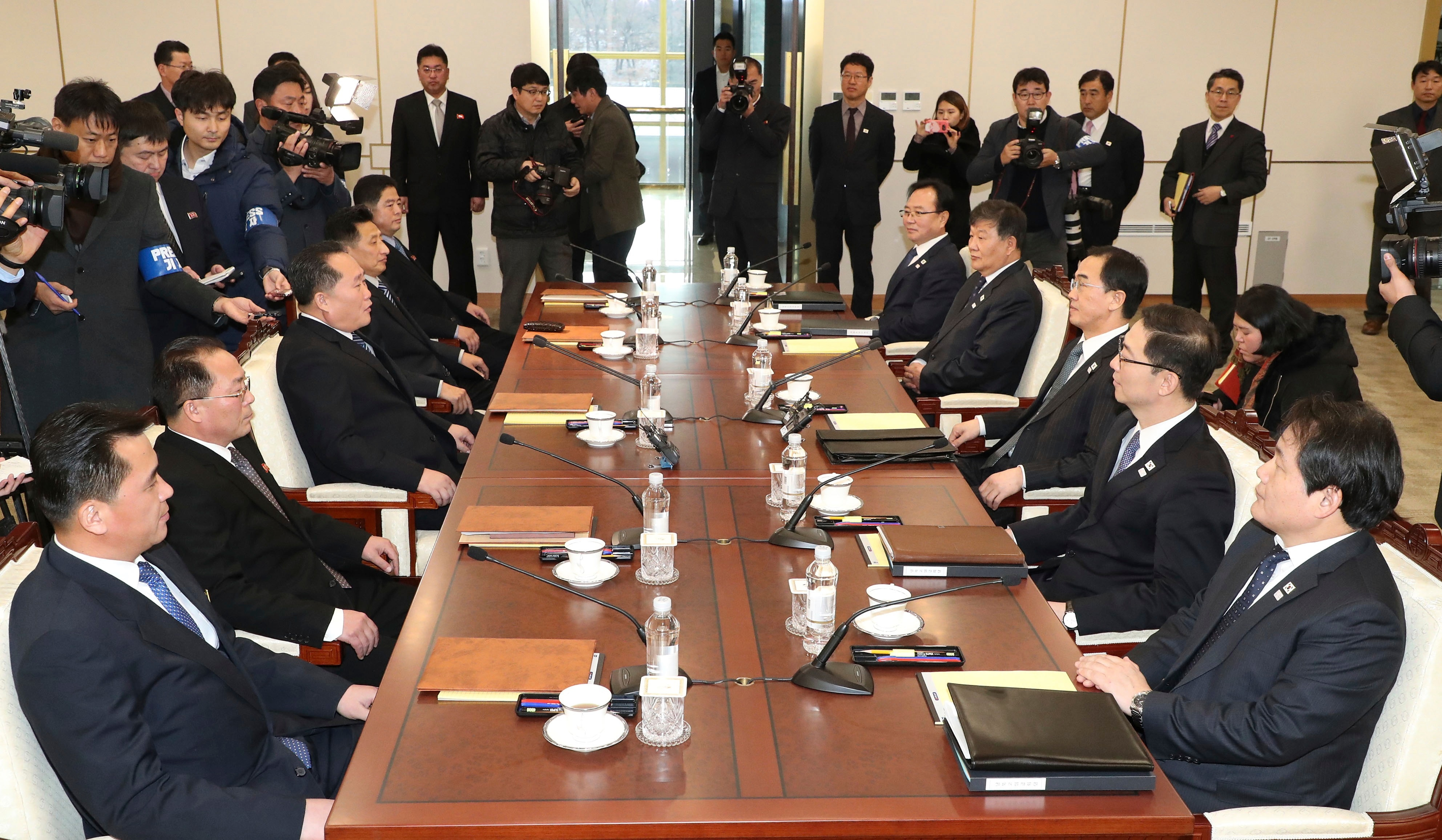 South and North Korean delegations meet at the Panmunjom in the Demilitarized Zone in Paju, South Korea.