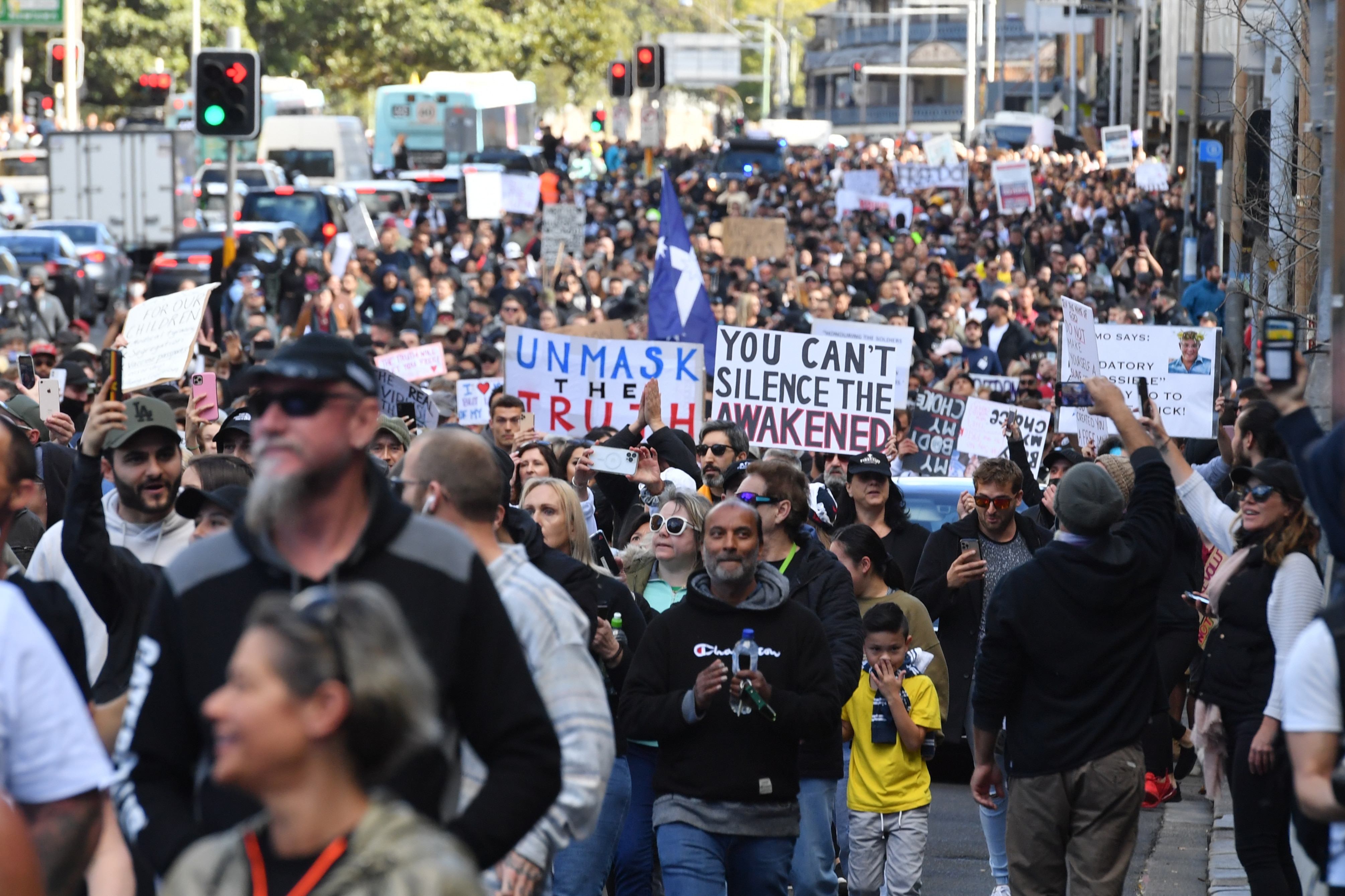 Protesters march along Broadway and George St towards Sydney Town Hall during the 'World Wide Rally For Freedom' anti-lockdown rally at Hyde Park in Sydney, Saturday, July 24, 2021. (AAP Image/Mick Tsikas) NO ARCHIVING