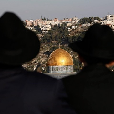 Ultra Orthodox Jews look towards the Haram el-Sherif (Noble Sanctuary), or The Temple Mount to Jews, in the Old City of Jerusalem